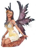 Light Fairy with Dark Wings Sitting